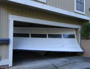 Garage door off its tracks