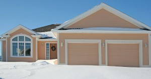 House with garage doors in winter