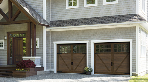 Craftsman-style house with cedar shingles and wooden beams and columns. Garage doors: Princeton P-23, 8' x 7', Chocolate Walnut doors and overlays, 8-lite Panoramic windows.