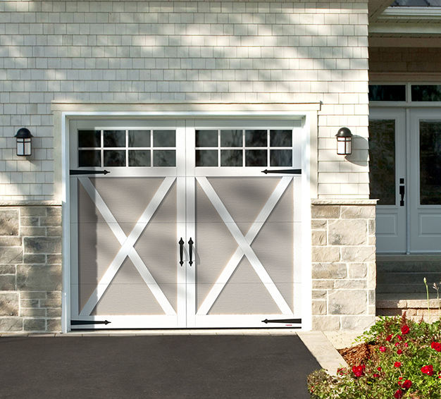 Single Carriage House Style garage door with the Eastman E-21 design in the Claystone door color with Ice White overlays