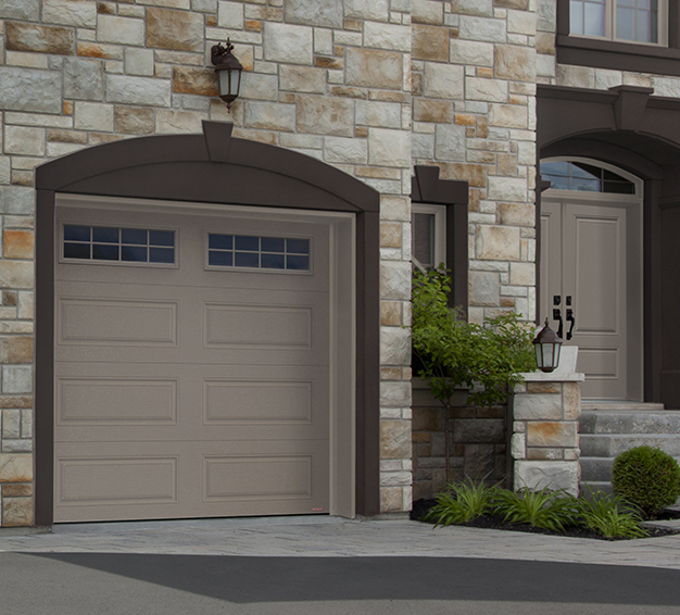 Single Traditional Style garage door with the Classic XL design in the Claystone color