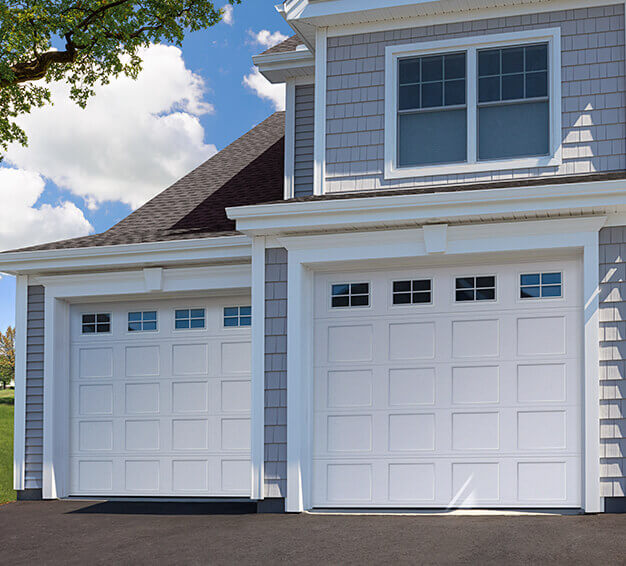 Double Traditional Style garage doors with the Shaker-Flat Short design in the White color