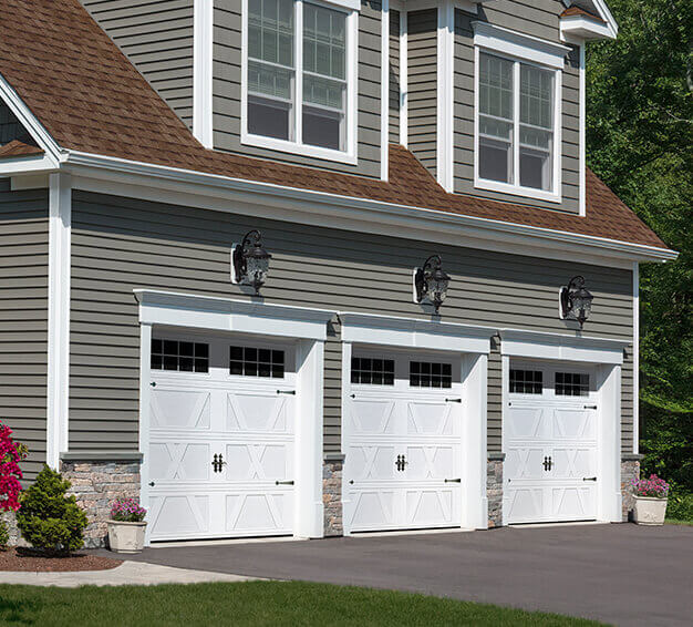 3 Carriage House Style garage doors with the X Layout, Flat base design in the Ice White color