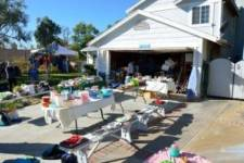 driveway with garage sale going on