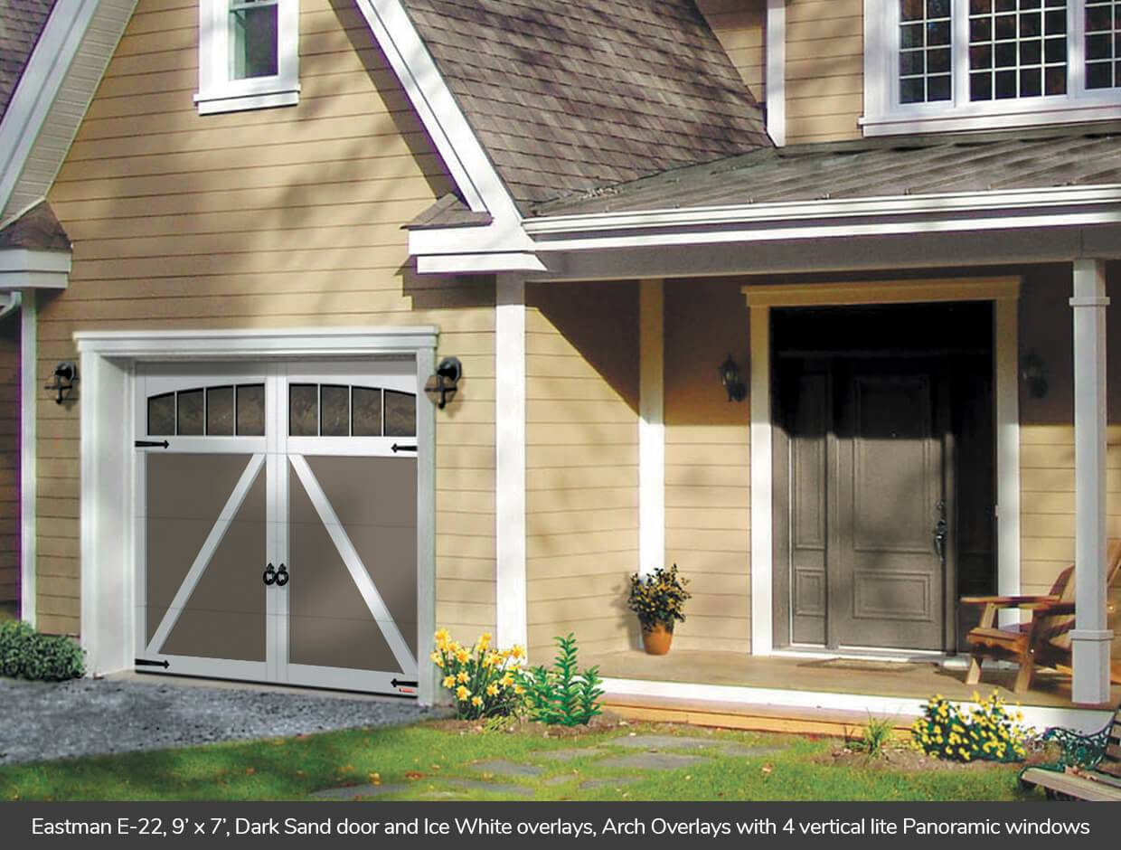 Eastman E-22, 9' x 7', Dark Sand door and Ice White overlays, Arch Overlays with 4 vertical lite Panoramic windows