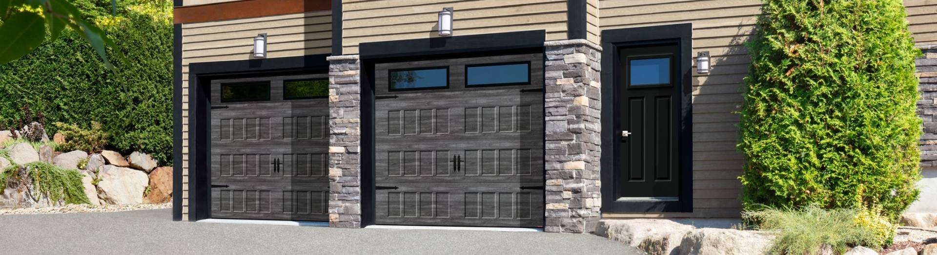 Carriage House style house with 2 Standard+ garage doors, Shaker-Flat XS design in the new Iron Ore Walnut colour